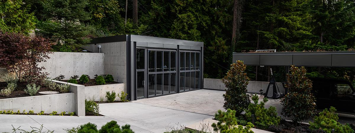 Backyard storage building with bi-fold door
